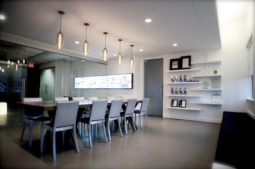 Pharos Modern Pendant Lights over a boardroom table