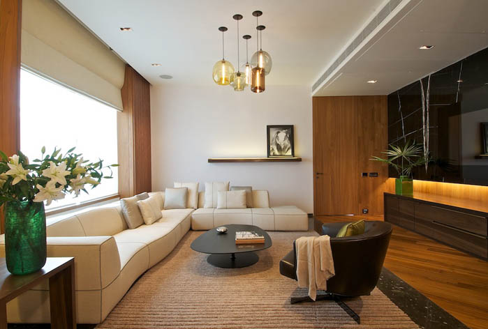 A Cluster of Niche Modern Pendant Lights in a Rajiv Saini & Associates Interior