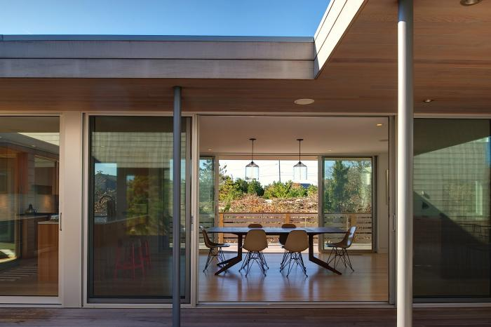 Bell Jar Pendants Hang in an Amagansett Home by Stelle Architects