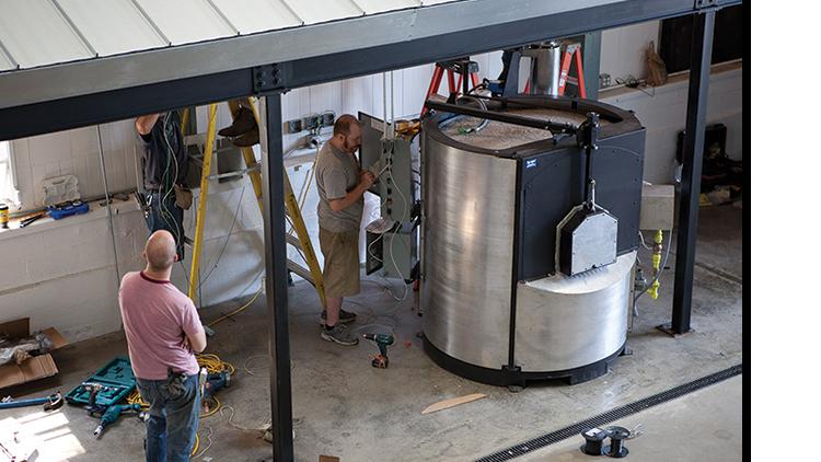 modern lighting company installs glassblowing equipment